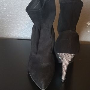 Black booties with sparkly studded heels